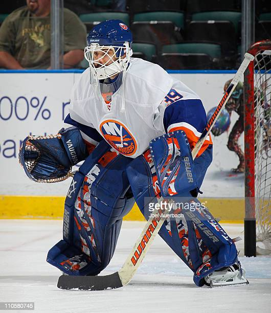 Goaltender Rick DiPietro of the New York Islanders warms up prior to the NHL game against the Florida Panthers on March 19 2011 at the BankAtlantic...