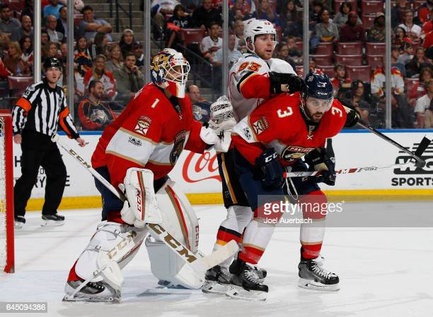 Goaltender Roberto Luongo defends the net as Keith Yandle of the Florida Panthers is checked by Sam Bennett of the Calgary Flames at the BBT Center...