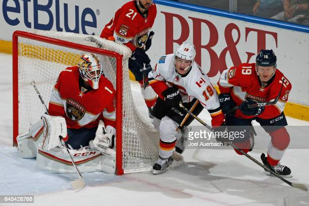 Goaltender Roberto Luongo guards the post as Michael Matheson of the Florida Panthers checks Matthew Tkachuk of the Calgary Flames at the BBT Center...