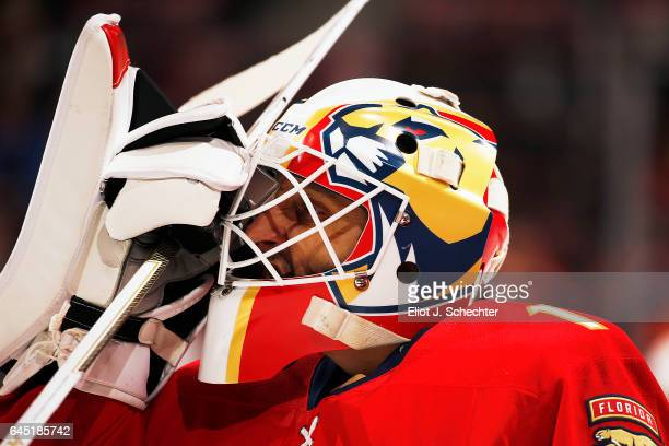 Goaltender Roberto Luongo of the Florida Panthers adjusts his gear on the ice during warm ups prior to the start of the game against the Edmonton...