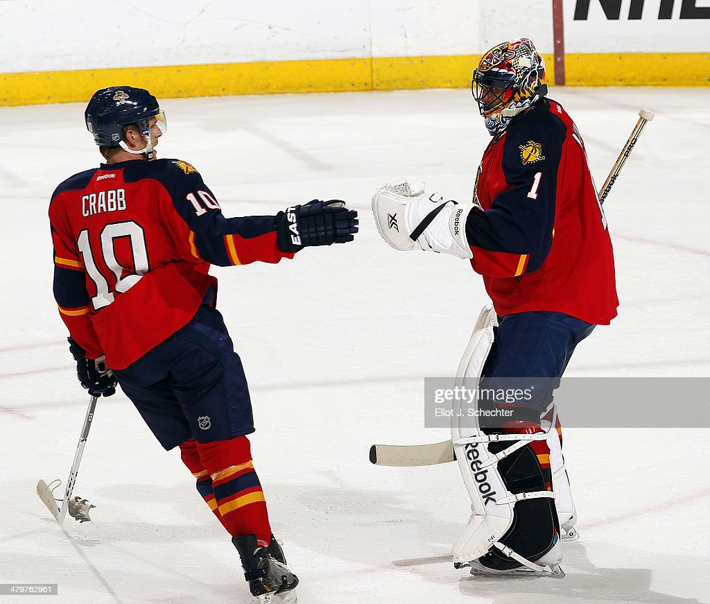 Goaltender Roberto Luongo of the Florida Panthers celebrates their win with teammate Joey Crabb against the New Jersey Devils at the BBT Center on...