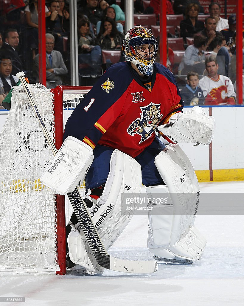 Goaltender <a gi-track='captionPersonalityLinkClicked' href=/galleries/search?phrase=Roberto+Luongo&family=editorial&specificpeople=202638 ng-click='$event.stopPropagation()'>Roberto Luongo</a> #1 of the Florida Panthers defends the net against the Calgary Flames at the BB&T Center on April 4, 2014 in Sunrise, Florida. The Flames defeated the Panthers 2-1. Luongo was playing in his 800th NHL game.