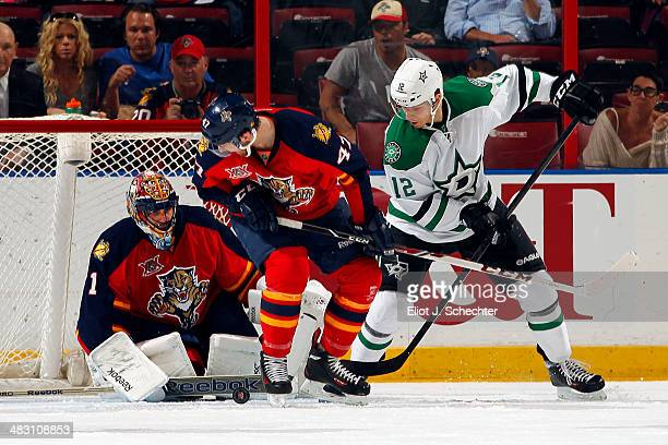 Goaltender Roberto Luongo of the Florida Panthers defends the net with the help of teammate Colby Robak against Alex Chiasson of the Dallas Stars at...