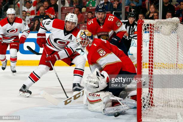 Goaltender Roberto Luongo of the Florida Panthers defends the net against Victor Rask of the Carolina Hurricanes at the BBT Center on February 28...