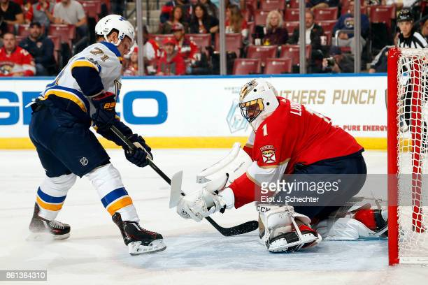 Goaltender Roberto Luongo of the Florida Panthers defends the net against Vladimir Sobotka of the St Louis Blues at the BBT Center on October 12 2017...