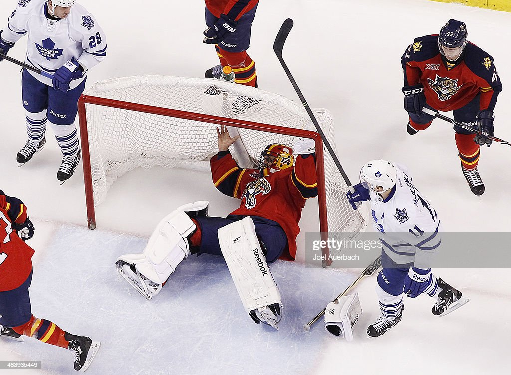 Goaltender <a gi-track='captionPersonalityLinkClicked' href=/galleries/search?phrase=Roberto+Luongo&family=editorial&specificpeople=202638 ng-click='$event.stopPropagation()'>Roberto Luongo</a> #1 of the Florida Panthers ends up in the net after colliding with <a gi-track='captionPersonalityLinkClicked' href=/galleries/search?phrase=Jay+McClement&family=editorial&specificpeople=575233 ng-click='$event.stopPropagation()'>Jay McClement</a> #11 of the Toronto Maple Leafs at the BB&T Center on April 10, 2014 in Sunrise, Florida. The Panthers defeated the Maple Leafs 4-2.
