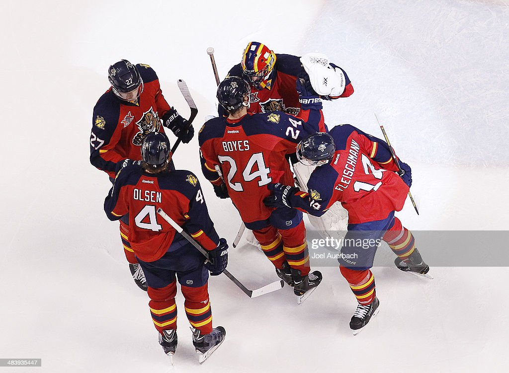 Goaltender <a gi-track='captionPersonalityLinkClicked' href=/galleries/search?phrase=Roberto+Luongo&family=editorial&specificpeople=202638 ng-click='$event.stopPropagation()'>Roberto Luongo</a> #1 of the Florida Panthers is congratulated by teammates after the victory against the Toronto Maple Leafs at the BB&T Center on April 10, 2014 in Sunrise, Florida. The Panthers defeated the Maple Leafs 4-2.
