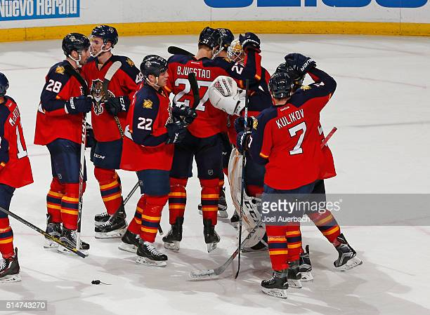 Goaltender Roberto Luongo of the Florida Panthers is congratulated by teammates after the game against the Ottawa Senators at the BBT Center on March...