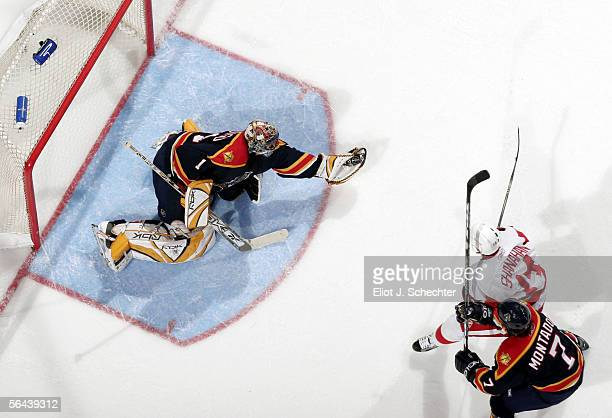 Goaltender Roberto Luongo of the Florida Panthers makes a save with teammate Steve Montador near by against Brendan Shanahan of the Detroit Redwings...