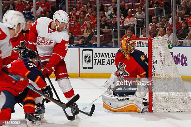 Goaltender Roberto Luongo of the Florida Panthers stops a shot by Joakim Andersson of the Detroit Red Wings during first period action at the BBT...