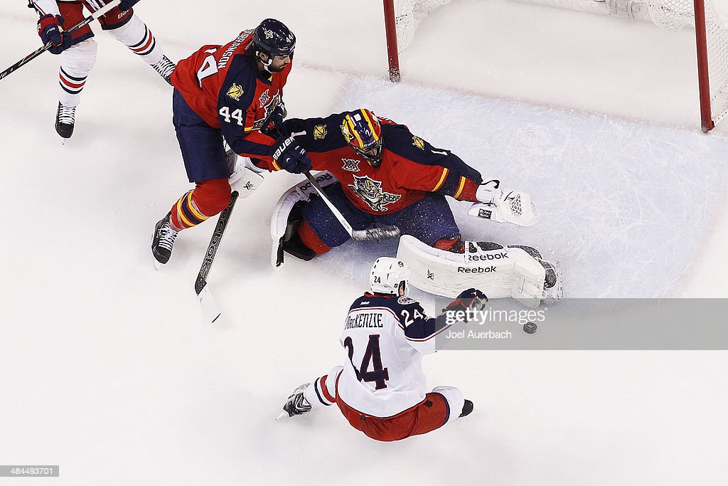 Goaltender <a gi-track='captionPersonalityLinkClicked' href=/galleries/search?phrase=Roberto+Luongo&family=editorial&specificpeople=202638 ng-click='$event.stopPropagation()'>Roberto Luongo</a> #1 of the Florida Panthers stops a shot by <a gi-track='captionPersonalityLinkClicked' href=/galleries/search?phrase=Derek+MacKenzie&family=editorial&specificpeople=685877 ng-click='$event.stopPropagation()'>Derek MacKenzie</a> #24 of the Columbus Blue Jackets at the BB&T Center on April 12, 2014 in Sunrise, Florida. The Blue Jackets defeated the Panthers 3-2.