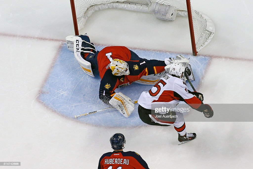 Goaltender Roberto Luongo #1 of the Florida Panthers stops a shot by Zack Smith #15 of the Ottawa Senators during first period action at the BB&T Center on March 10, 2016 in Sunrise, Florida. The Panthers defeated the Senators 6-2.
