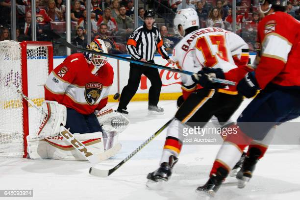 Goaltender Roberto Luongo of the Florida Panthers stops a shot by Johnny Gaudreau of the Calgary Flames during second period action at the BBT Center...