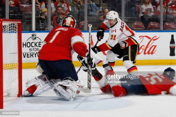 Goaltender Roberto Luongo of the Florida Panthers stops a shot by Mikael Backlund of the Calgary Flames during second period action at the BBT Center...