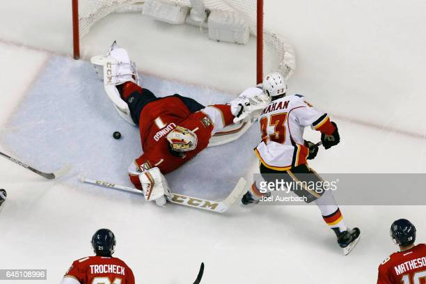 Goaltender Roberto Luongo of the Florida Panthers stops a shot by Sean Monahan of the Calgary Flames during third period action at the BBT Center on...