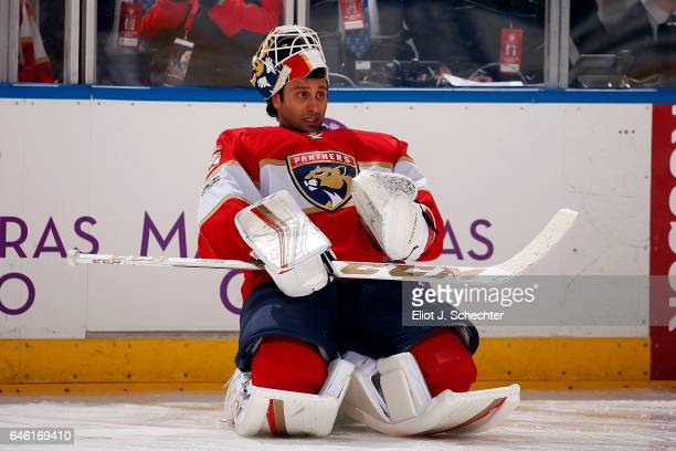 Goaltender Roberto Luongo of the Florida Panthers stretches on the ice for warm ups prior to the start of the game against the Ottawa Senators at the...