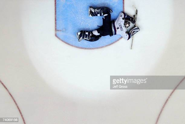 Goaltender Roberto Luongo of the Vancouver Canucks lays on the ice after giving up the game winning goal to the Anaheim Ducks in double overtime of...