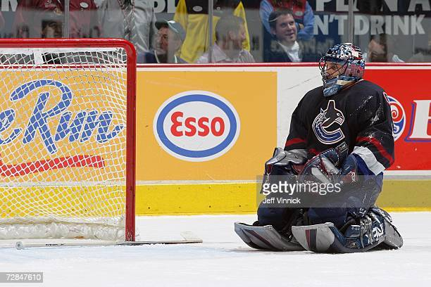 Goaltender Roberto Luongo of the Vancouver Canucks looks on while on his leg pads during a break in game action against the Carolina Hurricanes at...