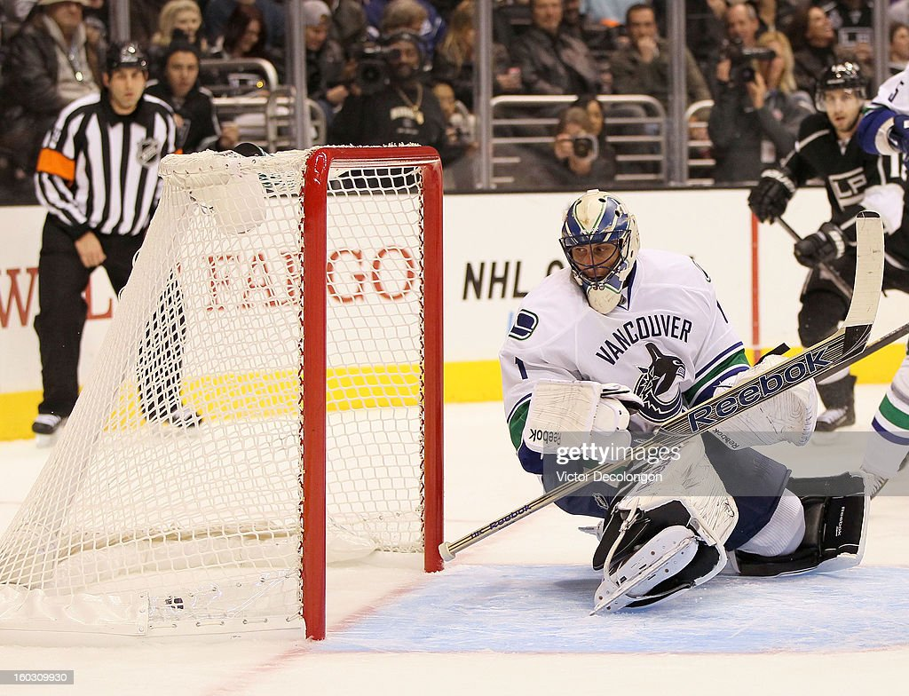 Goaltender Roberto Luongo #1 of the Vancouver Canucks loses his stick as he watches the puck go into the net for a goal from a shot by Jeff Carter #77 of the Los Angeles Kings (not in photo) in the second period during the NHL game at Staples Center on January 28, 2013 in Los Angeles, California. The Kings defeated the Canucks 3-2 in shootout overtime.