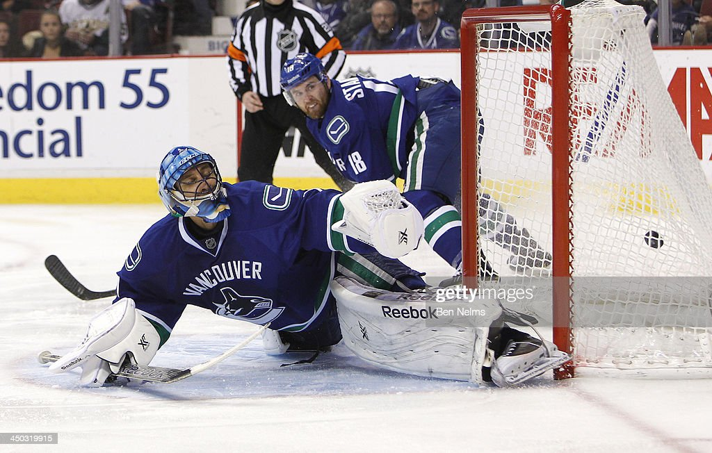 Goaltender <a gi-track='captionPersonalityLinkClicked' href=/galleries/search?phrase=Roberto+Luongo&family=editorial&specificpeople=202638 ng-click='$event.stopPropagation()'>Roberto Luongo</a> #1 of the Vancouver Canucks reacts after being scored on by Erik Cole #72 of the Dallas Stars during the third period of their NHL game at Rogers Arena on November 17, 2013 in Vancouver, British Columbia, Canada.