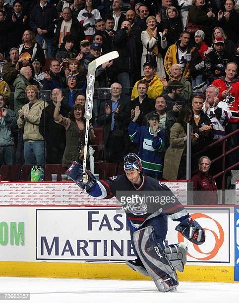 Goaltender Roberto Luongo of the Vancouver Canucks waves to the crowd after being named first star at the end of their game against the Nashville...