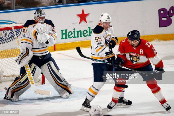Goaltender Robin Lehner of the Buffalo Sabres defends the net with teammate Rasmus Ristolainen against Shawn Thornton of the Florida Panthers at the...