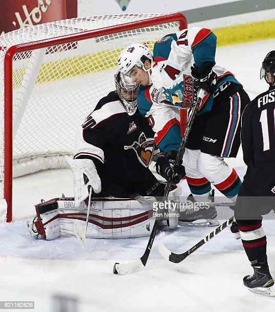 Goaltender Ryan Kubic of the Vancouver Giants makes a save against Nick Merkley of the Kelowna Rockets during the third period of their WHL game at...