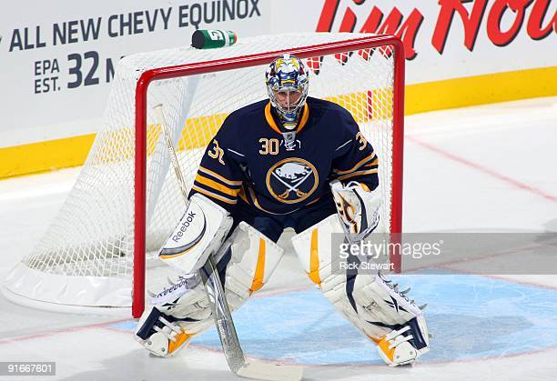 Goaltender Ryan Miller of the Buffalo Sabres defends his net against the Montreal Canadiens during the NHL game at HSBC Arena on October 3 2009 in...