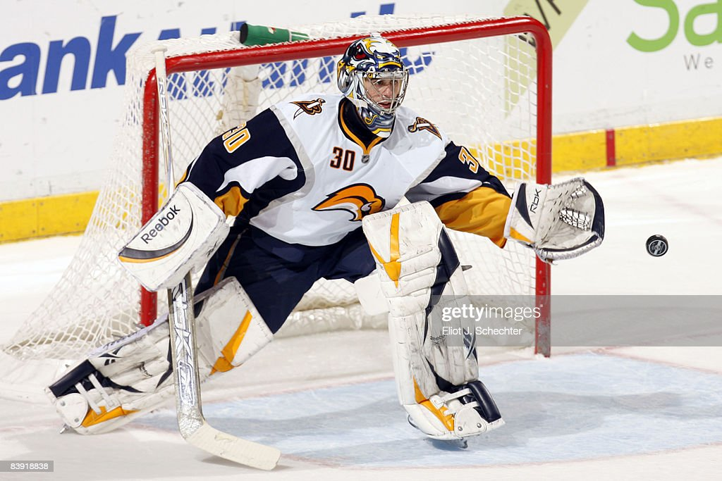 Goaltender Ryan Miller of the Buffalo Sabres defends the net against the Florida Panthers at the Bank Atlantic Center on December 4 2008 in Sunrise...