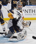 Goaltender Ryan Miller of the Buffalo Sabres guards the net against the New York Islanders at the Nassau Coliseum on January 16 2010 in Uniondale New...