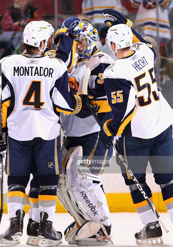 Goaltender <a gi-track='captionPersonalityLinkClicked' href=/galleries/search?phrase=Ryan+Miller+-+Ice+Hockey+Player&family=editorial&specificpeople=206960 ng-click='$event.stopPropagation()'>Ryan Miller</a> #30 of the Buffalo Sabres is congratulated by teammates <a gi-track='captionPersonalityLinkClicked' href=/galleries/search?phrase=Steve+Montador&family=editorial&specificpeople=208775 ng-click='$event.stopPropagation()'>Steve Montador</a> #4 and <a gi-track='captionPersonalityLinkClicked' href=/galleries/search?phrase=Jochen+Hecht&family=editorial&specificpeople=203184 ng-click='$event.stopPropagation()'>Jochen Hecht</a> #55 after defeating the Phoenix Coyotes in the NHL game at Jobing.com Arena on January 18, 2010 in Glendale, Arizona. The Sabres defeated the Coyotes 7-2.