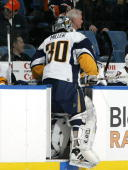 Goaltender Ryan Miller of the Buffalo Sabres leaves the ice for an extra skater late in the third period against the New York Islanders during their...