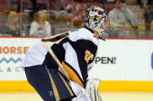 Goaltender Ryan Miller of the Buffalo Sabres looks up ice during a stop in play against the Phoenix Coyotes on January 18 2010 at Jobingcom Arena in...