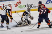 Goaltender Ryan Miller of the Buffalo Sabres makes a save against Steven Reinprecht of the Florida Panthers in the first period on October 21 2009 at...