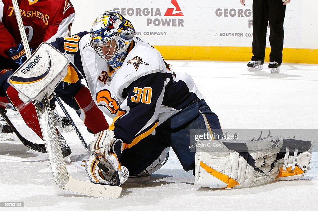 Goaltender Ryan Miller of the Buffalo Sabres saves a shot on goal by the Atlanta Thrashers at Philips Arena on January 14 2010 in Atlanta Georgia