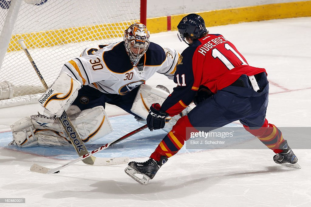 Goaltender Ryan Miller #30 of the Buffalo Sabres stops <a gi-track='captionPersonalityLinkClicked' href=/galleries/search?phrase=Jonathan+Huberdeau&family=editorial&specificpeople=7144196 ng-click='$event.stopPropagation()'>Jonathan Huberdeau</a> #11 of the Florida Panthers in a shootout at the BB&T Center on February 28, 2013 in Sunrise, Florida.