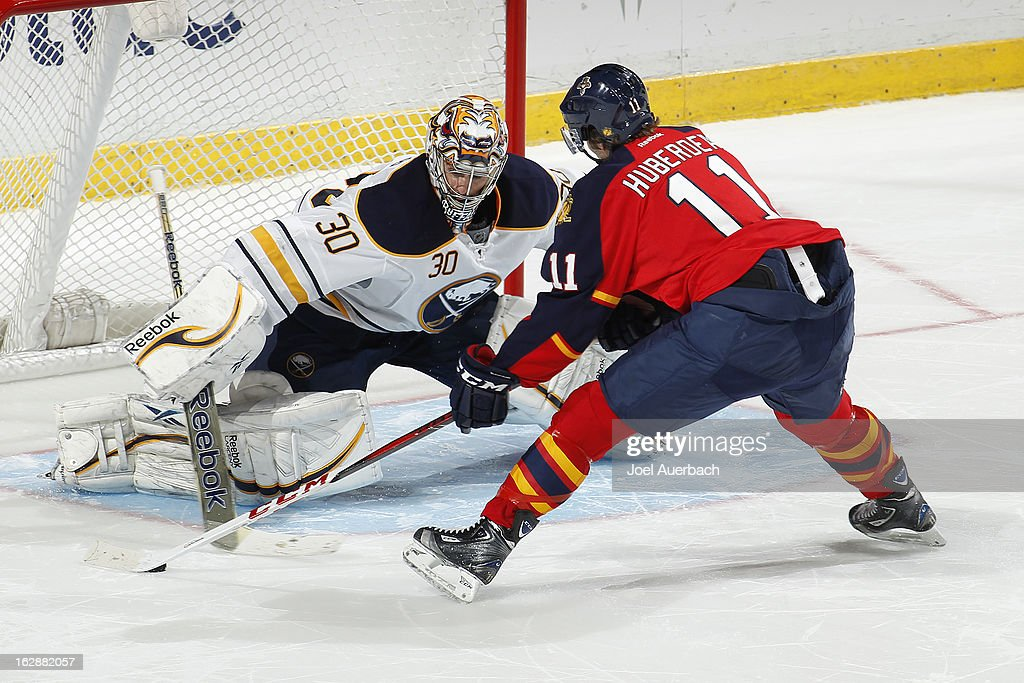 Goaltender Ryan Miller #30 of the Buffalo Sabres stops the shootout shot by <a gi-track='captionPersonalityLinkClicked' href=/galleries/search?phrase=Jonathan+Huberdeau&family=editorial&specificpeople=7144196 ng-click='$event.stopPropagation()'>Jonathan Huberdeau</a> #11 of the Florida Panthers at the BB&T Center on February 28, 2013 in Sunrise, Florida. The sabers defeated the Panthers 4-3 in a shootout.