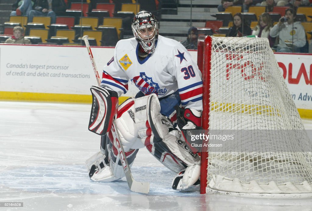 Goaltender Ryan Miller of the Rochester Americans in action against the Hamilton Bulldogs during the game at Copps Coliseum on January 26 2005 in...