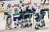 Goaltender Ryan Miller of the Vancouver Canucks celebrates their win with teammate Daniel Sedin against the Florida Panthers at the BBT Center on...