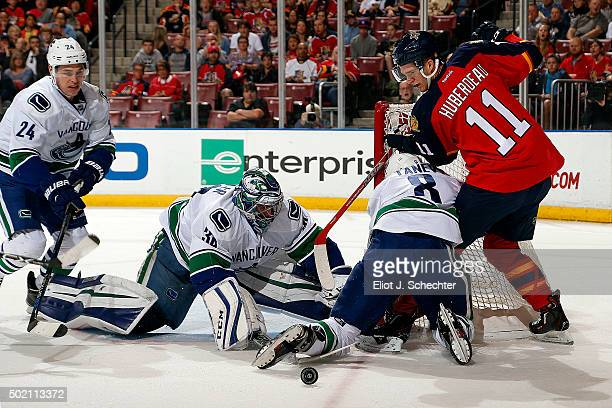 Goaltender Ryan Miller of the Vancouver Canucks defends the net against Jonathan Huberdeau of the Florida Panthers at the BBT Center on December 20...
