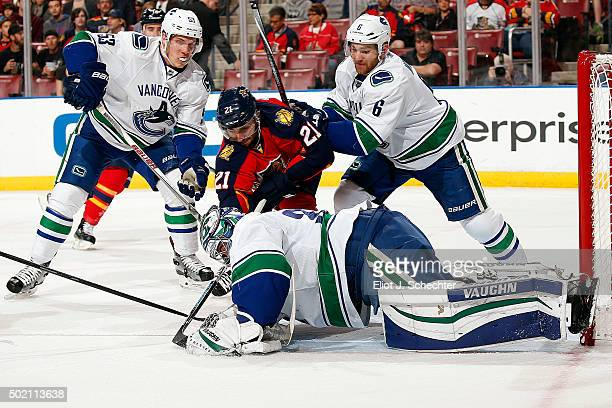Goaltender Ryan Miller of the Vancouver Canucks defends the net against Vincent Trocheck of the Florida Panthers at the BBT Center on December 20...