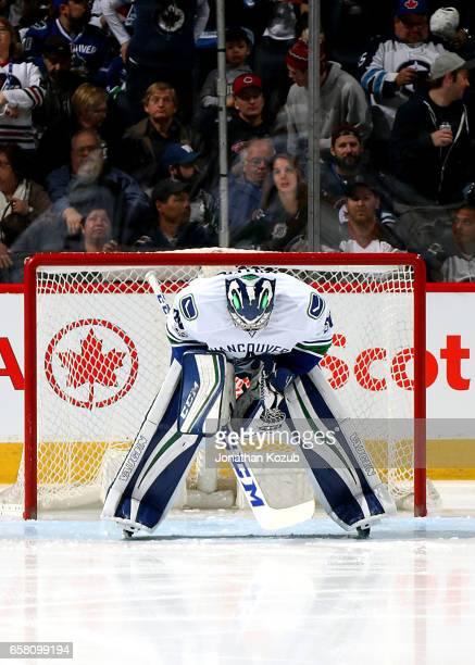 Goaltender Ryan Miller of the Vancouver Canucks gets set in the crease prior to puck drop against the Winnipeg Jets at the MTS Centre on March 26...