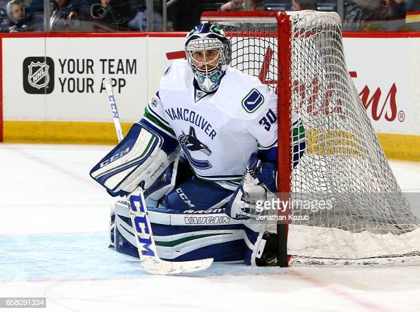 Goaltender Ryan Miller of the Vancouver Canucks takes part in the pregame warm up prior to NHL action against the Winnipeg Jets at the MTS Centre on...