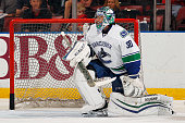 Goaltender Ryan Miller of the Vancouver Canucks warms up on the ice prior to the start of the game against the Florida Panthers at the BBT Center on...