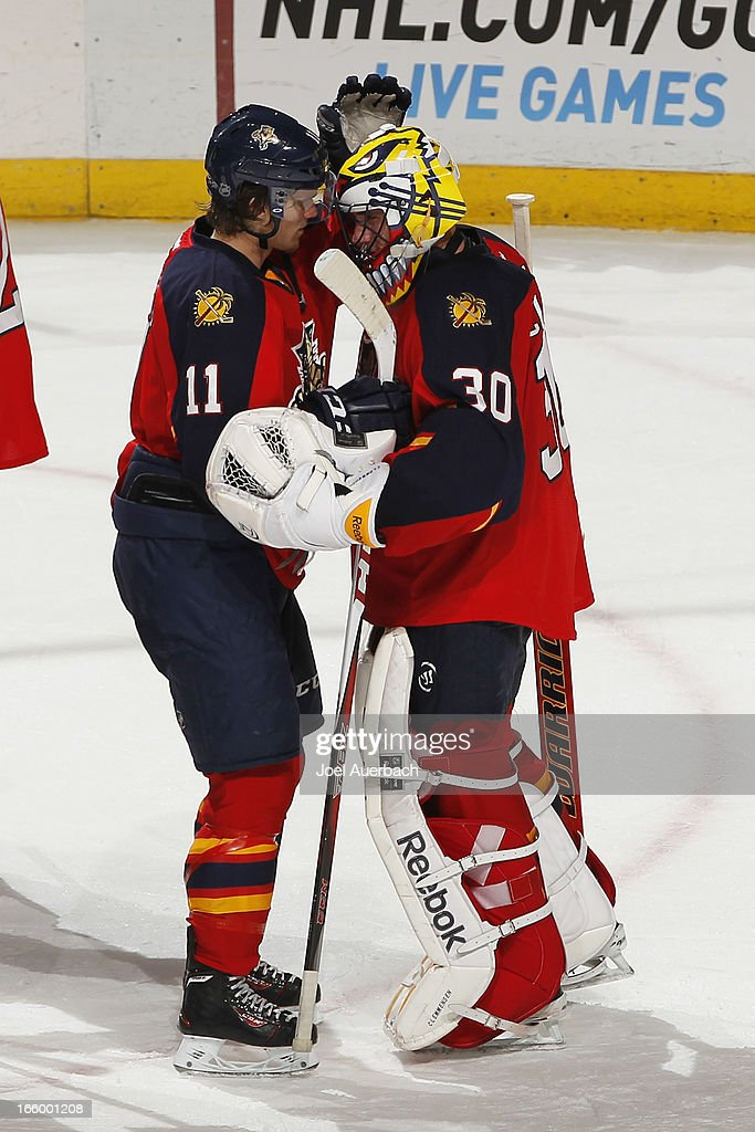 Goaltender <a gi-track='captionPersonalityLinkClicked' href=/galleries/search?phrase=Scott+Clemmensen&family=editorial&specificpeople=214674 ng-click='$event.stopPropagation()'>Scott Clemmensen</a> #30 is congratulated by <a gi-track='captionPersonalityLinkClicked' href=/galleries/search?phrase=Jonathan+Huberdeau&family=editorial&specificpeople=7144196 ng-click='$event.stopPropagation()'>Jonathan Huberdeau</a> #11 of the Florida Panthers at the conclusion of the game against the Ottawa Senators at the BB&T Center on April 7, 2013 in Sunrise, Florida. The Panthers defeated the Senators 2-1.