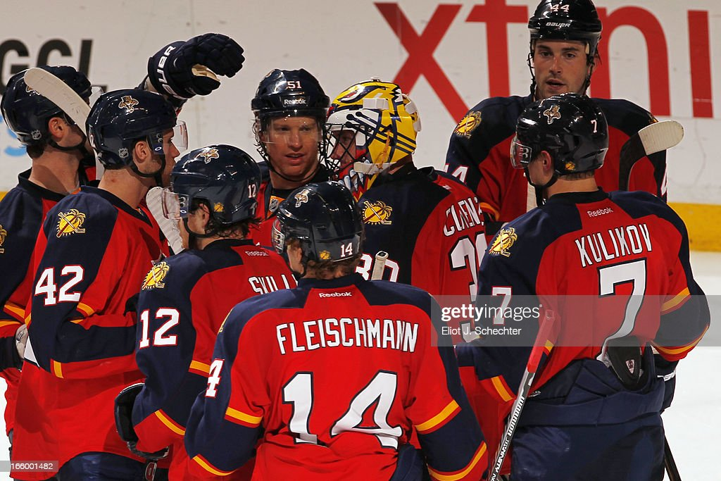 Goaltender <a gi-track='captionPersonalityLinkClicked' href=/galleries/search?phrase=Scott+Clemmensen&family=editorial&specificpeople=214674 ng-click='$event.stopPropagation()'>Scott Clemmensen</a> #30 of the Florida Panthers celebrates with teammates their 2-1 win against the Ottawa Senators at the BB&T Center on April 7, 2013 in Sunrise, Florida.