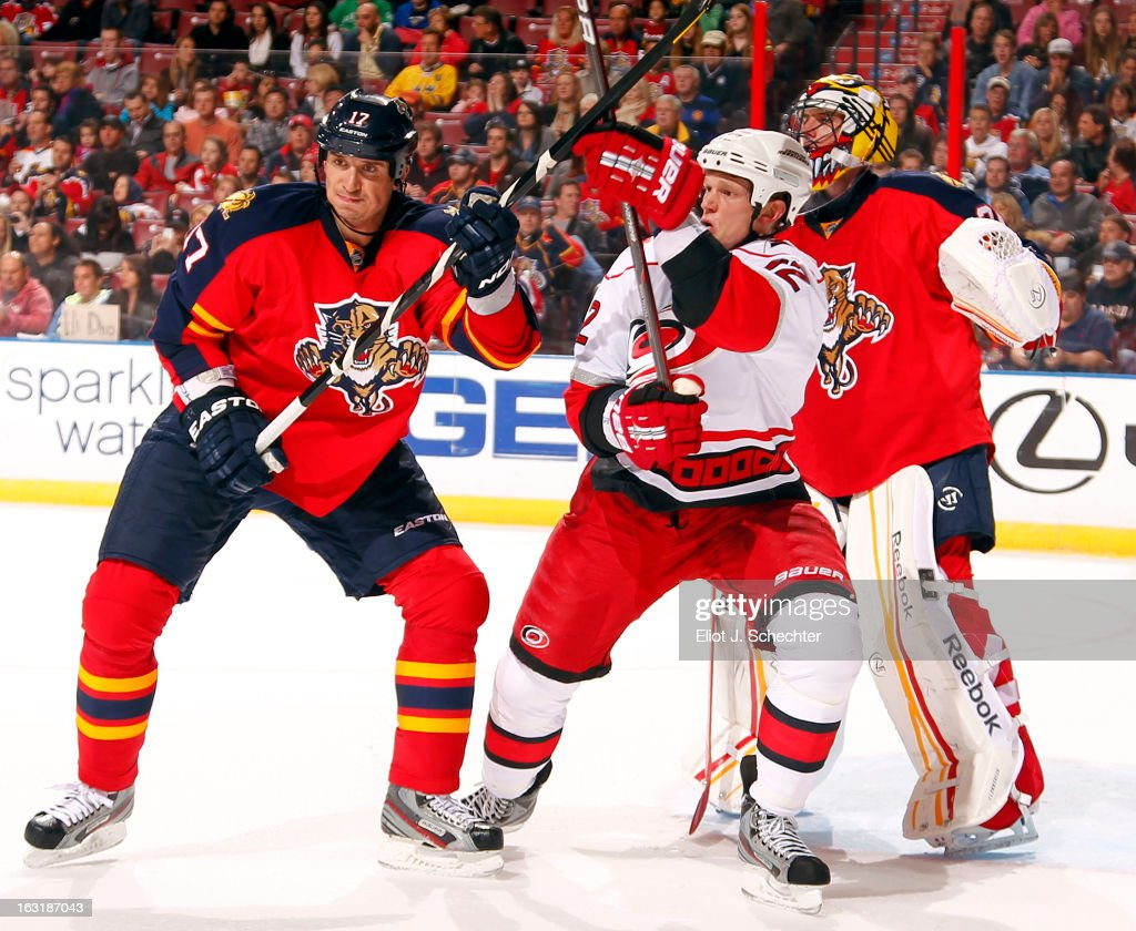 Goaltender Scott Clemmensen #30 of the Florida Panthers defends the net with the help of teammate Filip Kuba #17 against Eric Staal #12 of the Carolina Hurricanes at the BB&T Center on March 3, 2013 in Sunrise, Florida.