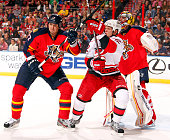 Goaltender Scott Clemmensen of the Florida Panthers defends the net with the help of teammate Filip Kuba against Eric Staal of the Carolina...