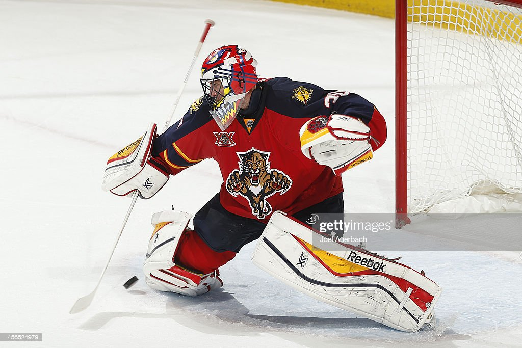 Goaltender Scott Clemmensen of the Florida Panthers defends the net against the Washington Capitals during overtime at the BBT Center on December 13...