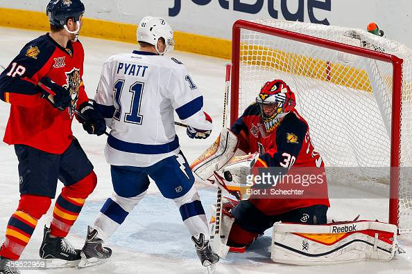 Goaltender Scott Clemmensen of the Florida Panthers defends the net with help from teammate Shawn Matthias against Tom Pyatt of the Tampa Bay...